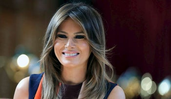 In this  Friday, July 13, 2018 file photo, first lady Melania Trump takes a seat during a visit to The Royal Hospital Chelsea in central London