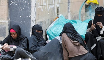 Women displaced by the fighting in the Red Sea port city of Hodeidah sit in the yard of a school allocated for IDPs in Sanaa, Yemen June 23, 2018