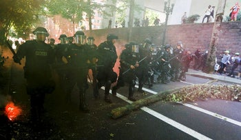 Police advance towards counter protesters during a rally by the Patriot Prayer group in Portland, Oregon, U.S. August 4, 2018