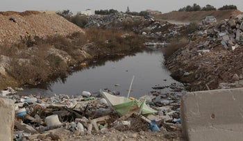 File photo: Garbage on the banks of Nahal Hebron, a stream originating in the West Bank city of Hebron.