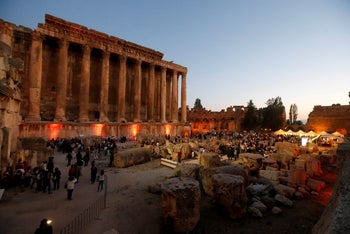 People gather to attend the opening of Baalbek International Festival, in Baalbek, Lebanon July 20, 2018.