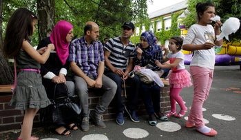 Syrian refugee families talk in the village Golzow, about 80 kilometers (50 miles) east of Berlin, Germany, May 27, 2016