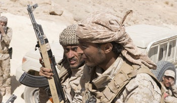 Yemeni government fighters waiting on the front line in a battle against Houthi rebels outside of Sanaa.