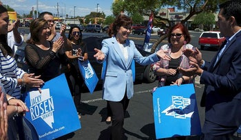 Representative Jacky Rosen, a Democrat from Nevada and Democratic U.S. Senate candidate, center, greets supporters ahead of early voting at Cardenas Supermarket in Las Vegas, Nevada, U.S., on Saturday, May 26, 2018