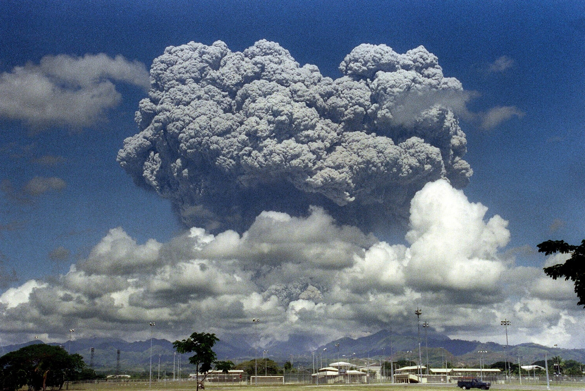 This picture taken 12 June 1991 shows a giant mushroom cloud of steam and ash exploding out of Mount Pinatubo volcano during its eruption