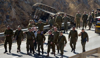Senior Israeli army officers at the scene of an accident where a cannon had rolled over during an IDF drill in the Golan Heights.
