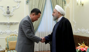 Hassan Rouhani greets North Korean Foreign Minister Ri Yong Ho at the presidency office in Tehran, Aug. 8, 2018.