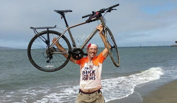 Bill Slott with his bike after completing the TransAm journey to San Francisco Bay, August 2, 2018.