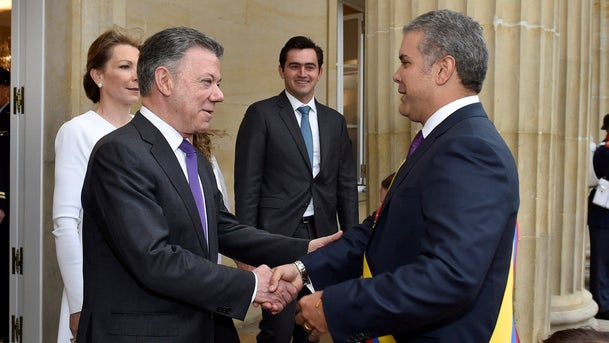 Colombia's new president, Ivan Duque, greets outgoing President Juan Manuel Santos in Bogota, Colombia, August 7, 2018.