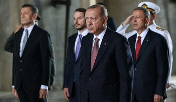 Turkish President Recep Tayyip Erdogan and members of the Supreme Military Council stand after laying a wreath during a visit of Anitkabir, the mausoleum of Mustafa Kemal Ataturk, August 2, 2018.