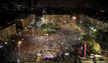 Israelis from the Druze minority, together with others, take part in a rally to protest against Jewish nation-state law in Rabin square in Tel Aviv, Israel, August 4, 2018