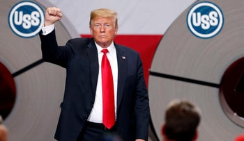 In this July 26, 2018, photo, President Donald Trump acknowledges the audience after speaking at the United States Steel Granite City Works plant in Granite City, Ill.