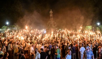 White nationalists circle the statue of Confederate general Robert E. Lee in a torch-lit march ahead of the 'Unite the Right' Rally in Charlottesville, Virginia. Aug 11, 2017