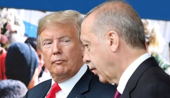 In this file photo taken on July 11, 2018 US President Donald Trump (L) talks to Turkey's President Recep Tayyip Erdogan (R) as they arrive for the NATO summit, at the NATO headquarters in Brussels.
