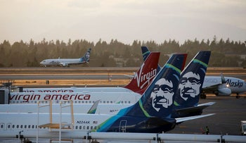 Alaska Airlines planes are pictured at Seattle-Tacoma International Airport the day after Horizon Air ground crew member Richard Russell took a plane from the airport in Seattle, Washington on August 11, 2018