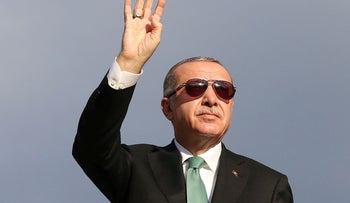 Turkish President Recep Tayyip Erdogan greeting his supporters in the Black Sea city of Trabzon, August 12, 2018.