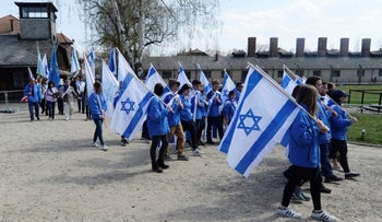 Young people marching between Auschwitz and Birkenau, April 12, 2018.