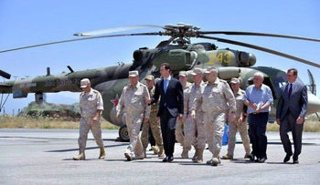 Syrian President Bashar Assad inspects the Russian Hemeimeem air base in the province of Latakia, Syria, June 27, 2017.