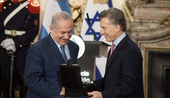 Argentinian President Mauricio Macri presents Prime Minister Benjamin Netanyahu with external hard drives containing information on the Holocaust, Buenos Aires, Argentina, September 12, 2017.