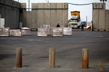 File photo, a truck parks next to a security barrier inside the Kerem Shalom border crossing terminal between Israel and Gaza Strip January 16, 2018.