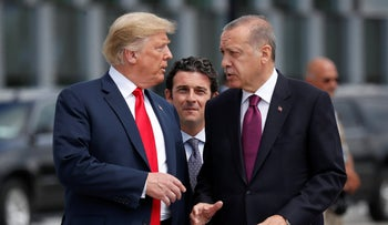 FILE PHOTO: Donald Trump and Recep Tayyip Erdogan arrive together at a summit of heads of state and government at NATO in Brussels on July 11, 2018.