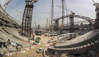 This file photo taken with a fisheye lens on February 6, 2018 shows construction work at the Al-Wakrah Stadium