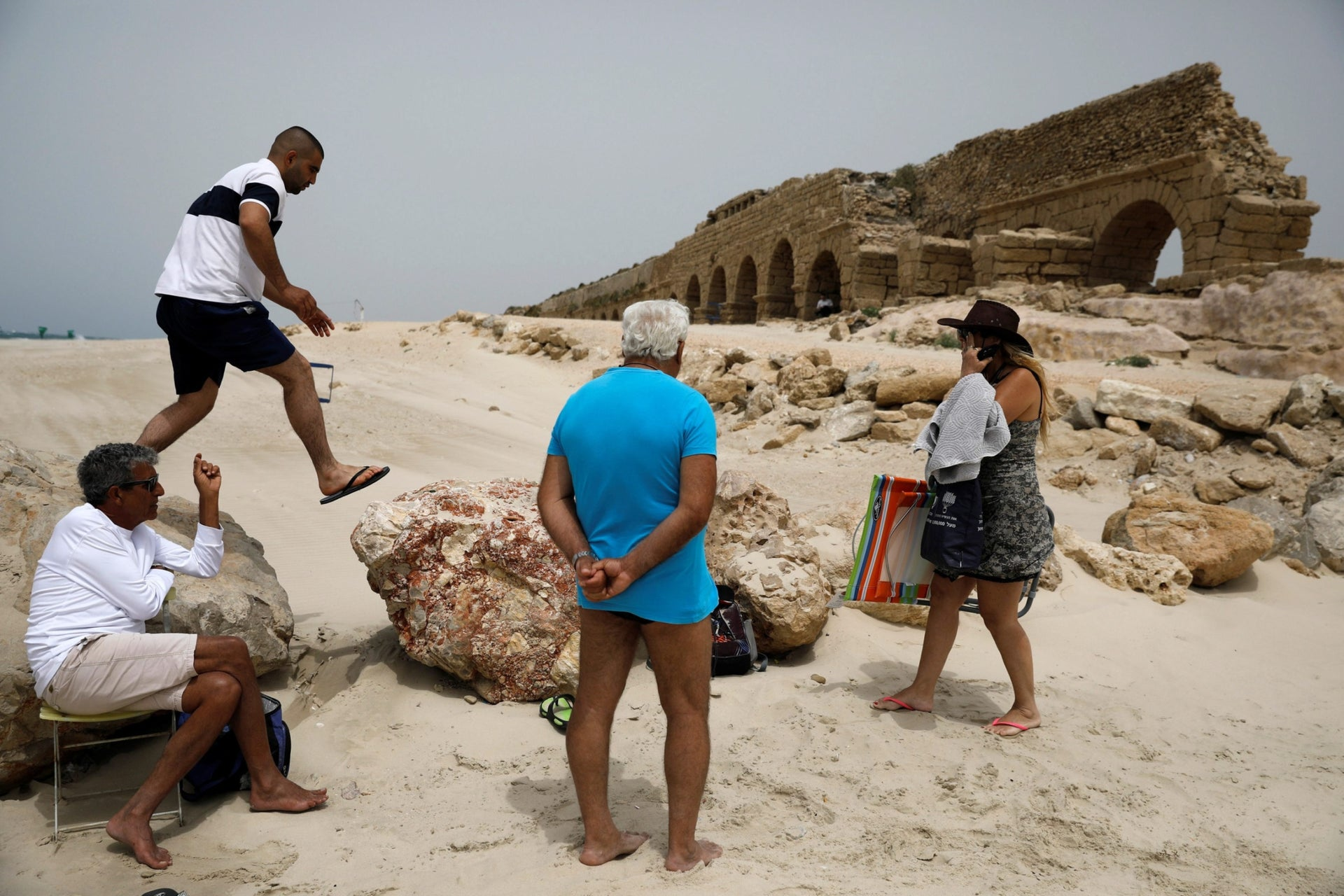Tourists visit the ruins in Caesarea.