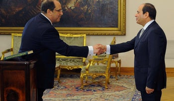 Egyptian President Abdel-Fattah al-Sissi (R) shakes hands after the swearing in of Major General Abbas Kamel, newly appointed chief of the country's General Intelligence Service on Thursday at the Ittihadiya presidential palace in Cairo, Egypt, June 28, 2018.