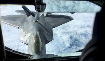 One of two U.S. Air Force F-22 stealth fighter jets receives fuel mid-air from a KC-135 refueling plane over Norway en route to a joint training exercise with Norway's growing fleet of F-35 jets August 15, 2018