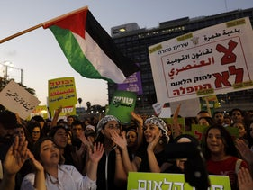 Demonstrators shout slogans as Israeli Arabs and their supporters march during a rally to protest the nation-state law, Tel Aviv, Israel, August 11, 2018.