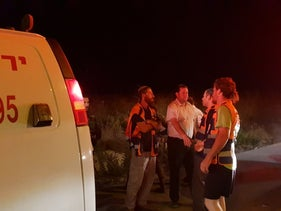 Emergency responders at the scene of a suspected car-ramming, Havat Gilad, West Bank, August 16, 2018.