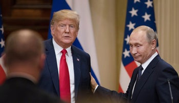 U.S. President Donald Trump, left, and Vladimir Putin, Russia's president, prepare to leave following a news conference in Helsinki, Finland, on Monday, July 16, 2018.