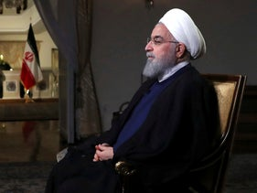 In this photo released by official website of the office of the Iranian Presidency, President Hassan Rouhani addresses the nation in a televised speech in Tehran, Iran, Aug. 6, 2018.