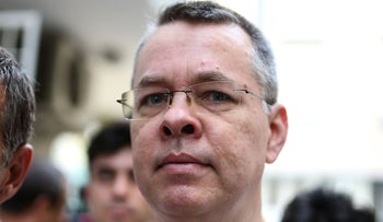 U.S. pastor Andrew Brunson escorted by Turkish police officers to his house in Izmir, July 25, 2018.