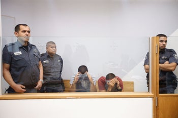 Police officers Nazia Saab and Bisan Yahya, suspected of stealing from migrant workers, at the Tel Aviv Magistrate's Court, August 2018.