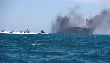 Revolutionary Guard speedboats assault a replica of a U.S. aircraft carrier during military drills in February 25, 2015