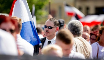 A man attends a demonstration commemorating the 31st death anniversary Hitler's deputy Rudolf Hess in Berlin, Aug 18, 2018.
