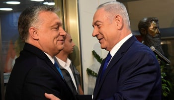 Hungarian Prime Minister Viktor Orban, left is welcomed by Israeli Prime Minister Benjamin Netanyahu upon his arrival, at the Prime Minister's office in Jerusalem, July 19, 2018.