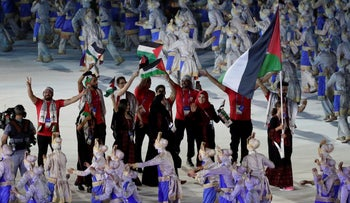 the Palestinian team marches in the opening ceremony of the 2018 Asia Games, held in Jakarta, August 18, 2018