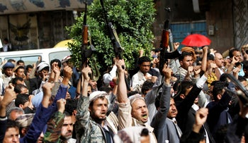 Houthi supporters rally against the alleged involvement of the United States in the deteriorating Yemeni economy in Sanaa, Yemen, August 17, 2018.