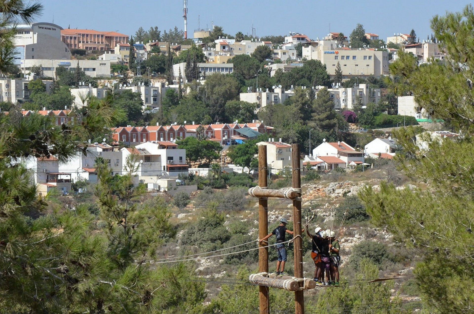 An activity at the National Leadership Center with the settlement of Ariel in the background, August, 2015.