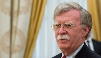 U.S. National Security Adviser John Bolton waits before a meeting with Russian President Vladimir Putin at the Kremlin in Moscow, Russia, June 27, 2018.