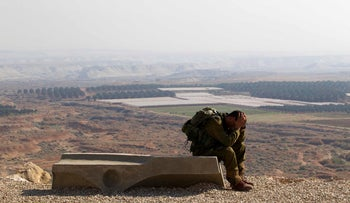 File photo: An Israeli soldier in the Jordan Valley in 2014.