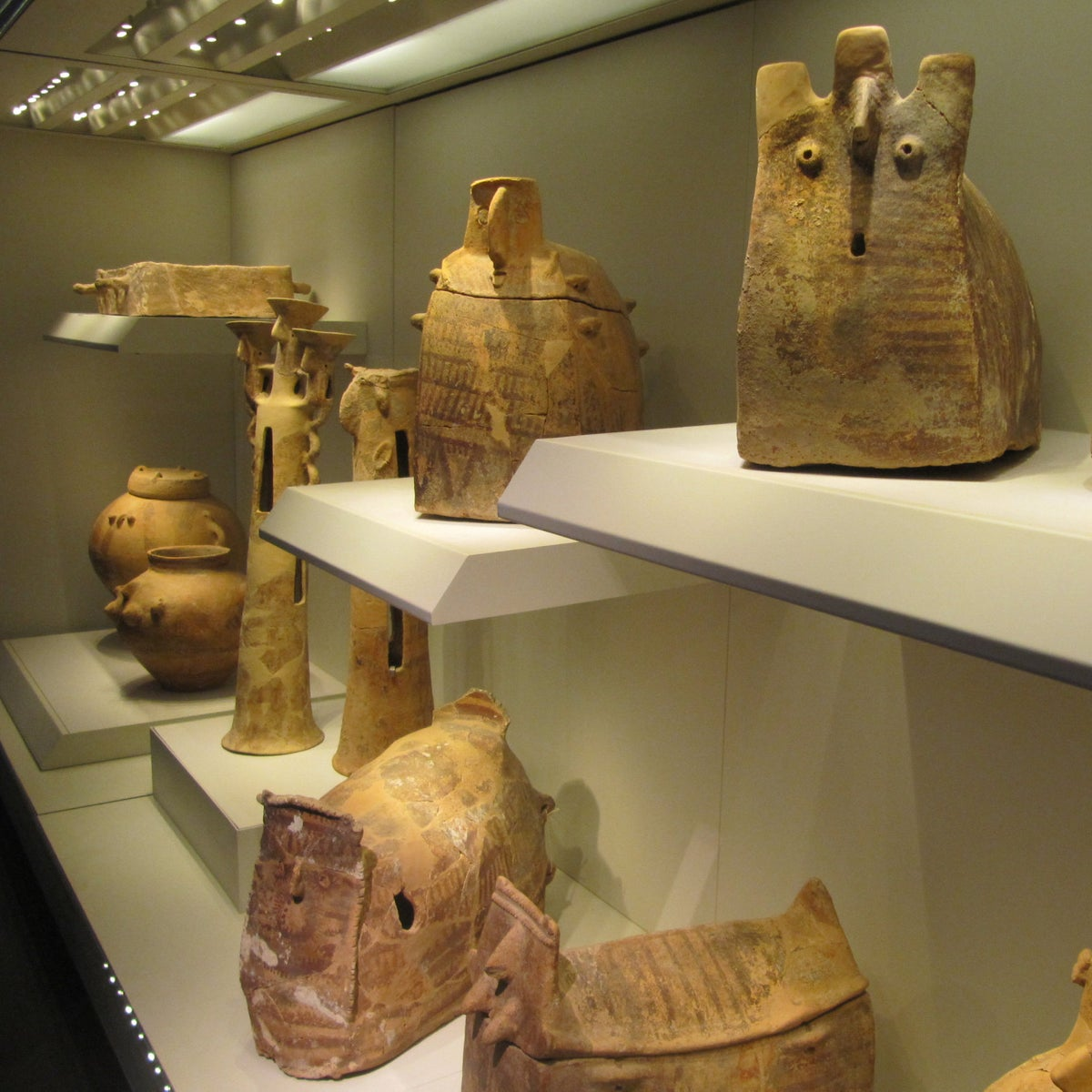 Unique secondary burial vessels from Peki'in: Photo shows the enormous variety of shapes burial vessels took in Israel 6,500 years ago. At the Israel Museum