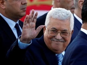Palestinian President Mahmoud Abbas waves during a mass wedding in Ramallah, West Bank, August 18, 2018.
