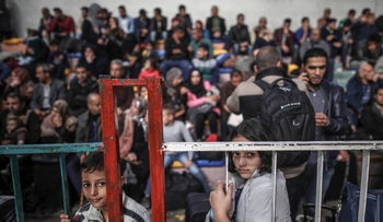 Palestinians waiting outside the Rafah crossing between Israel and the Strip.