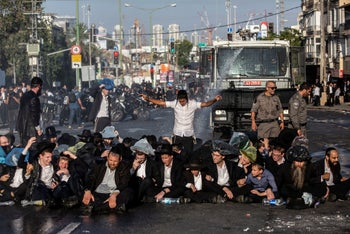 Ultra-Orthodox men protesting against forced draft into the Israeli military in Jerusalem.