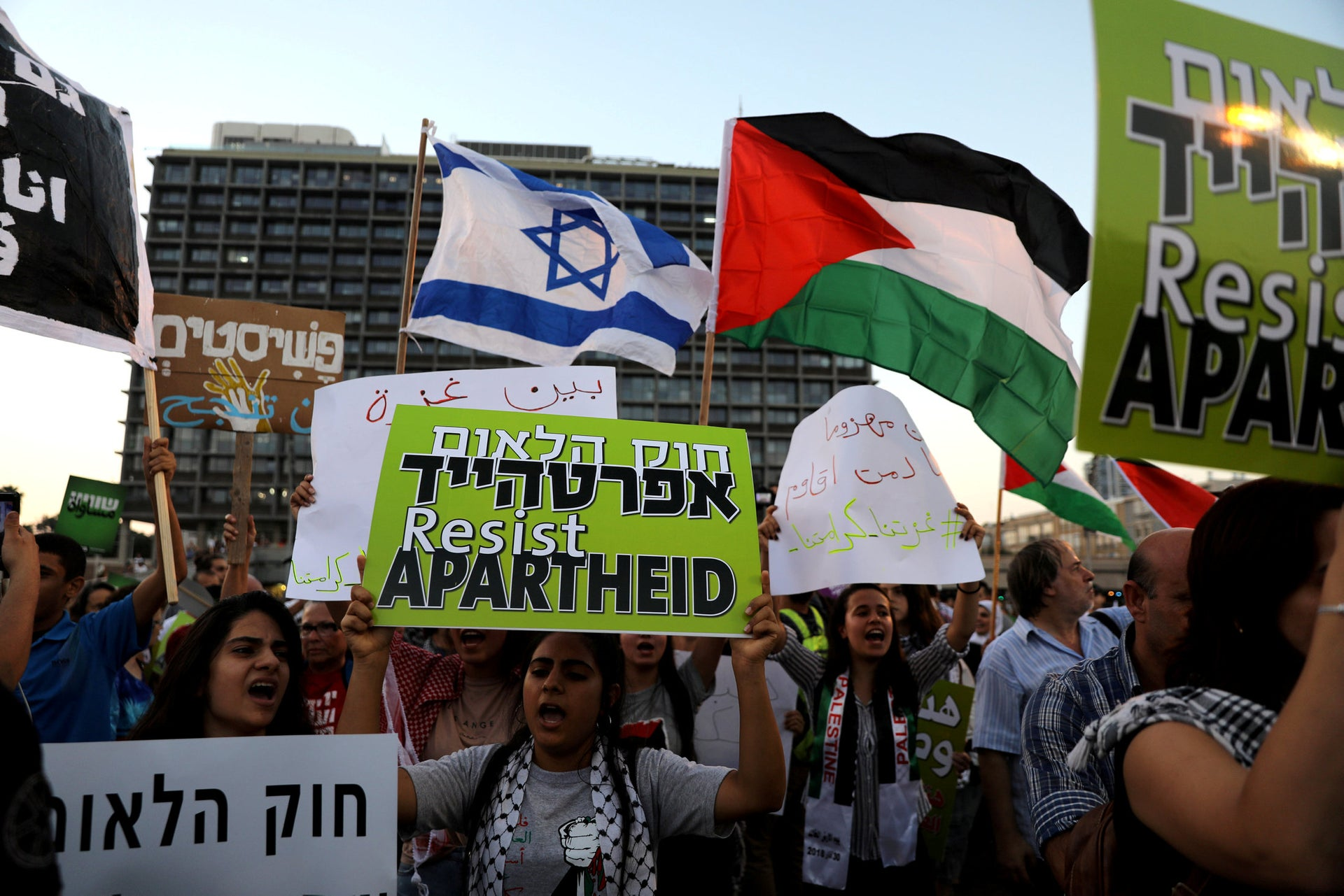 Israeli Arabs and their supporters take part in a rally to protest against Jewish nation-state law in Rabin square in Tel Aviv, Israel  August 11, 2018.