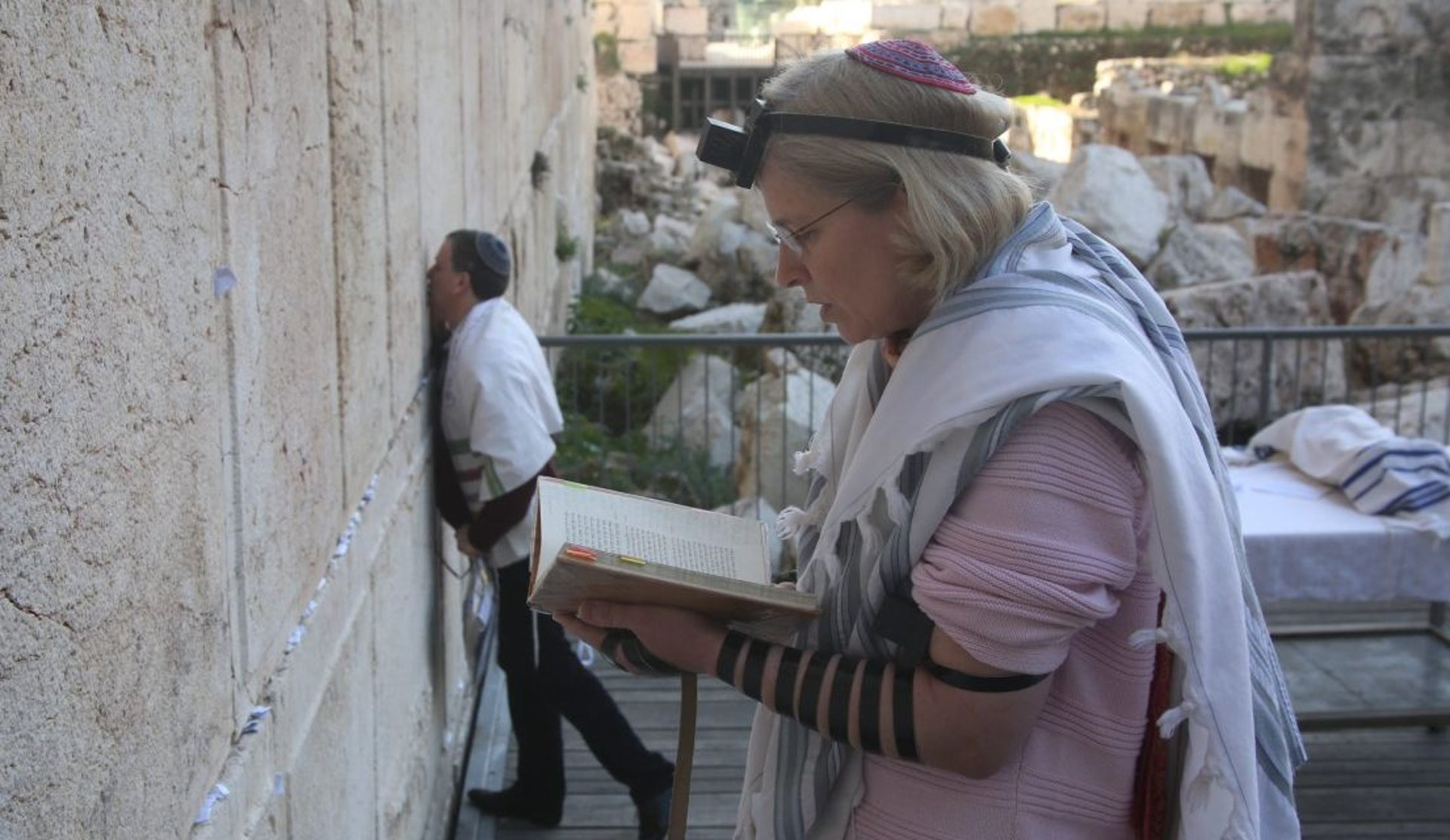 A woman prays at the Western Wall, Feb. 25, 2016.