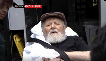 In this Monday, Aug. 20, 2018, frame from video, Jakiw Palij, a former Nazi concentration camp guard, is carried on a stretcher from his home in the Queens.